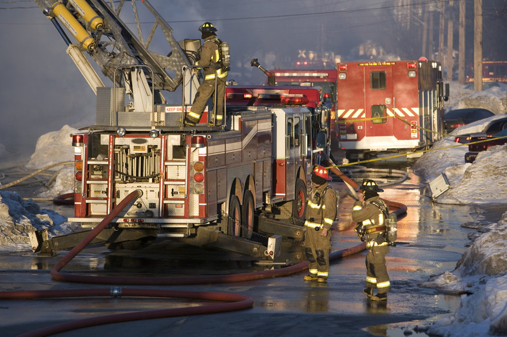 Firefighters battle a blaze