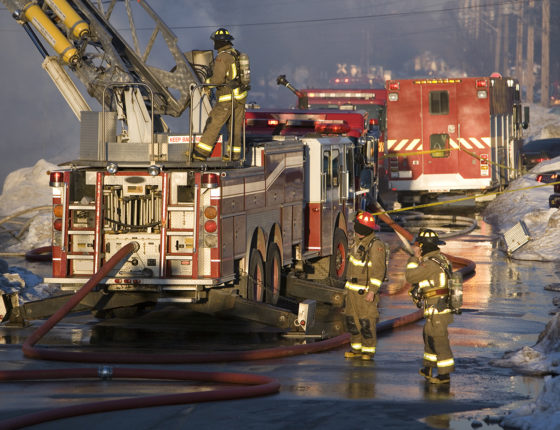 Firefighters battle a blaze