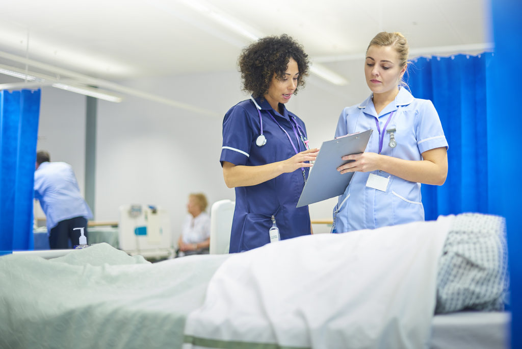 Clinicians deliver patient care in mobile healthcare facility