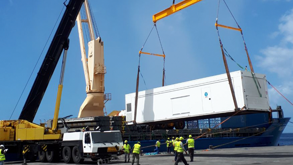 Mobile health unit is craned onto docks