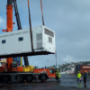 Mobile health unit lifted by crane